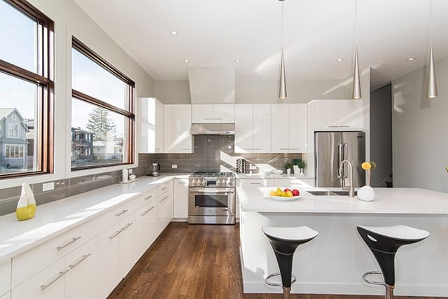 Beautiful open concept kitchen with island and white cabinets