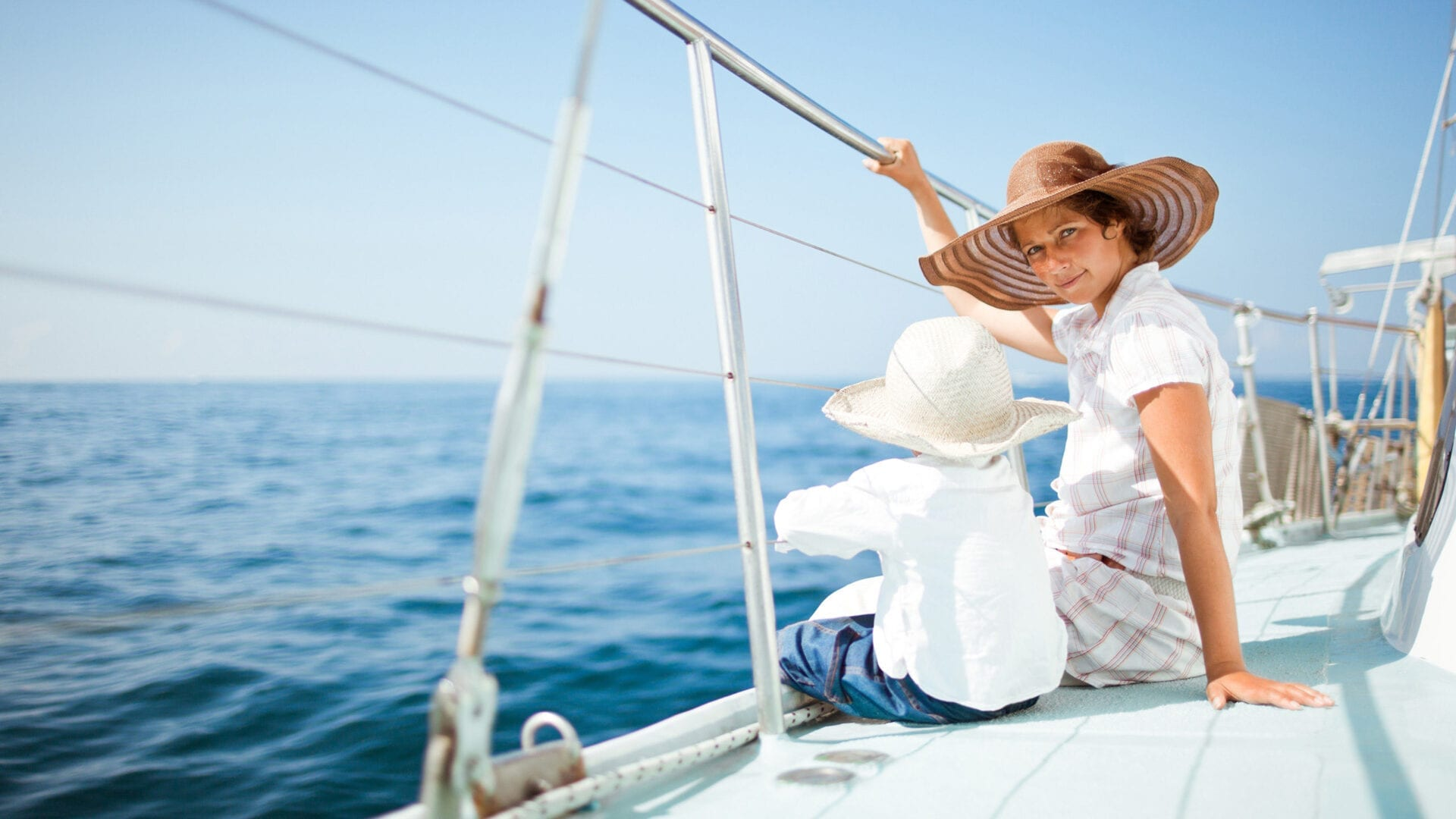 Mom and toddler on a sail boat