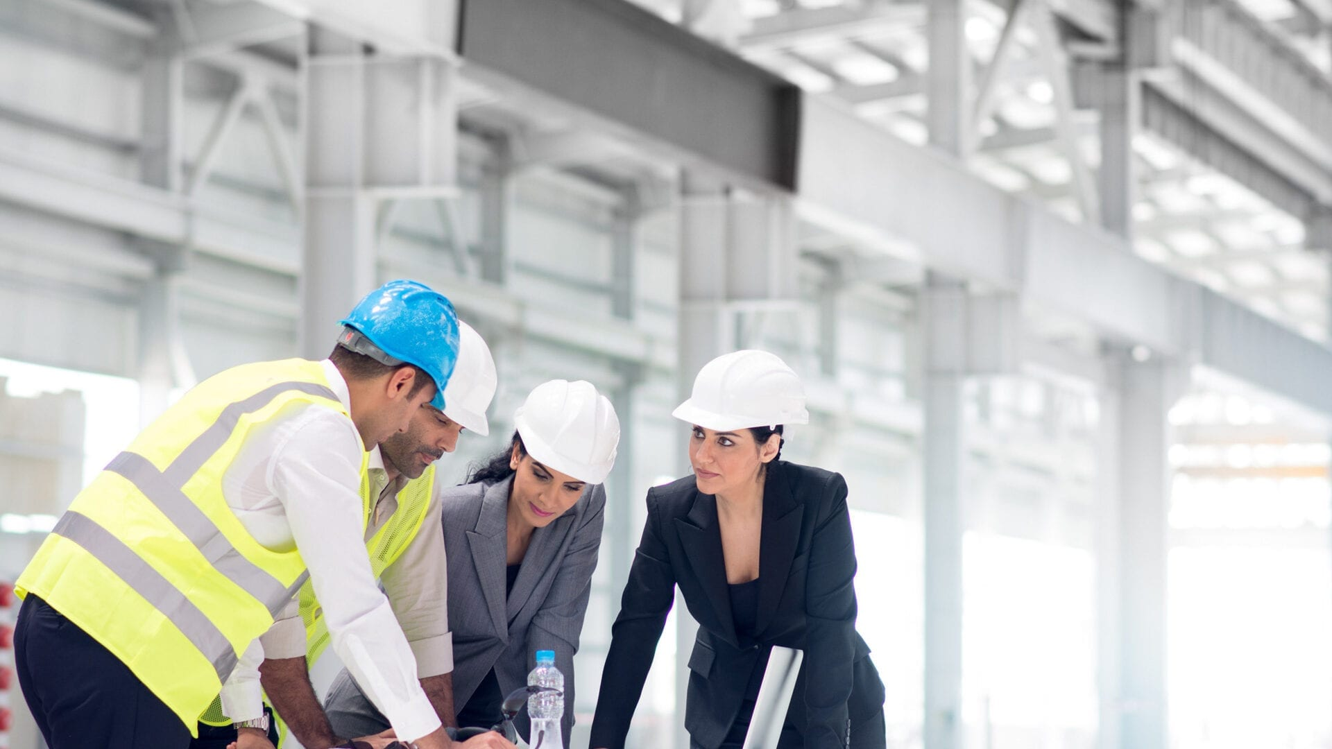 Team of construction workers reviewing plans