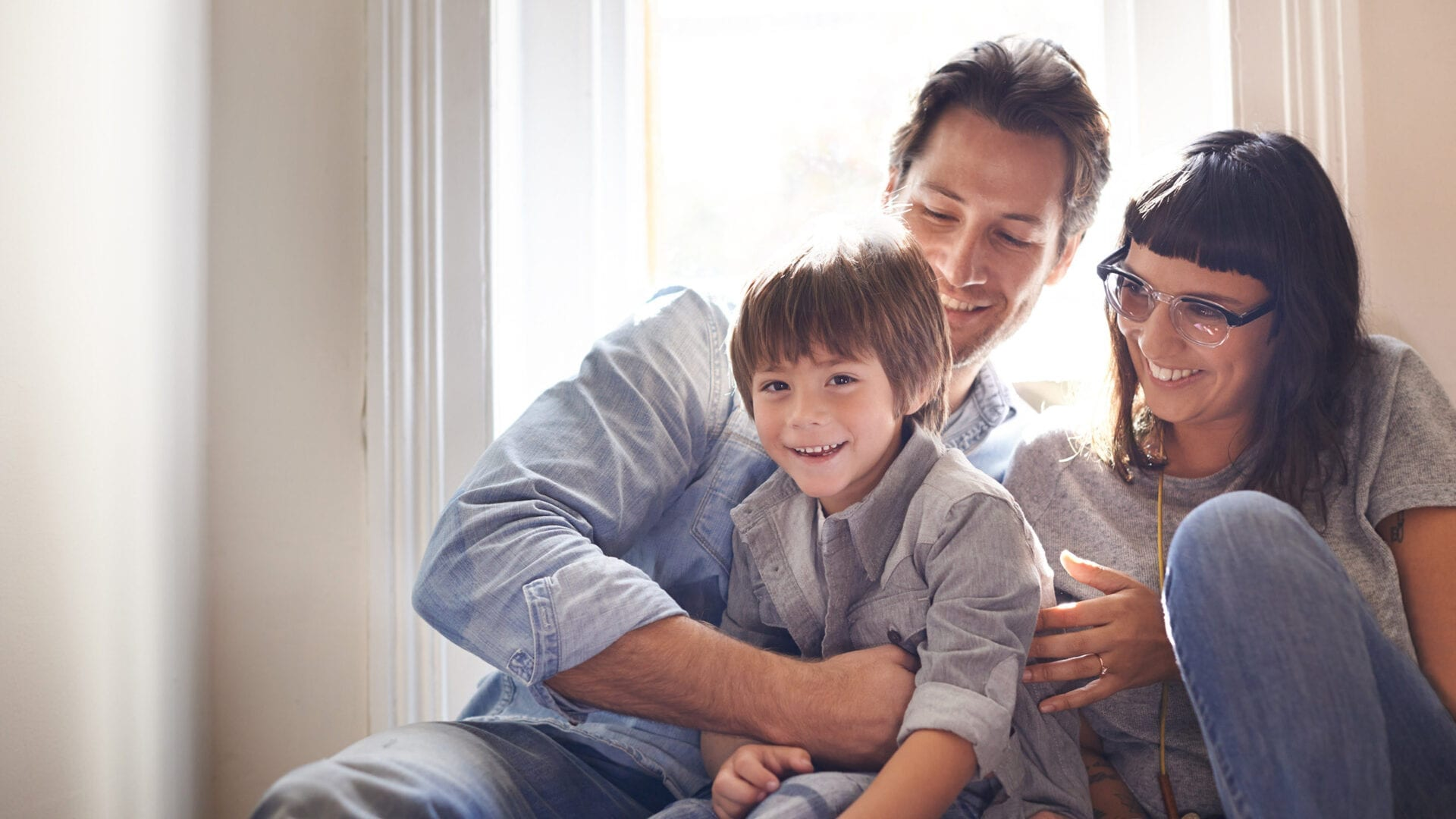 Couple and their son smiling and having fun