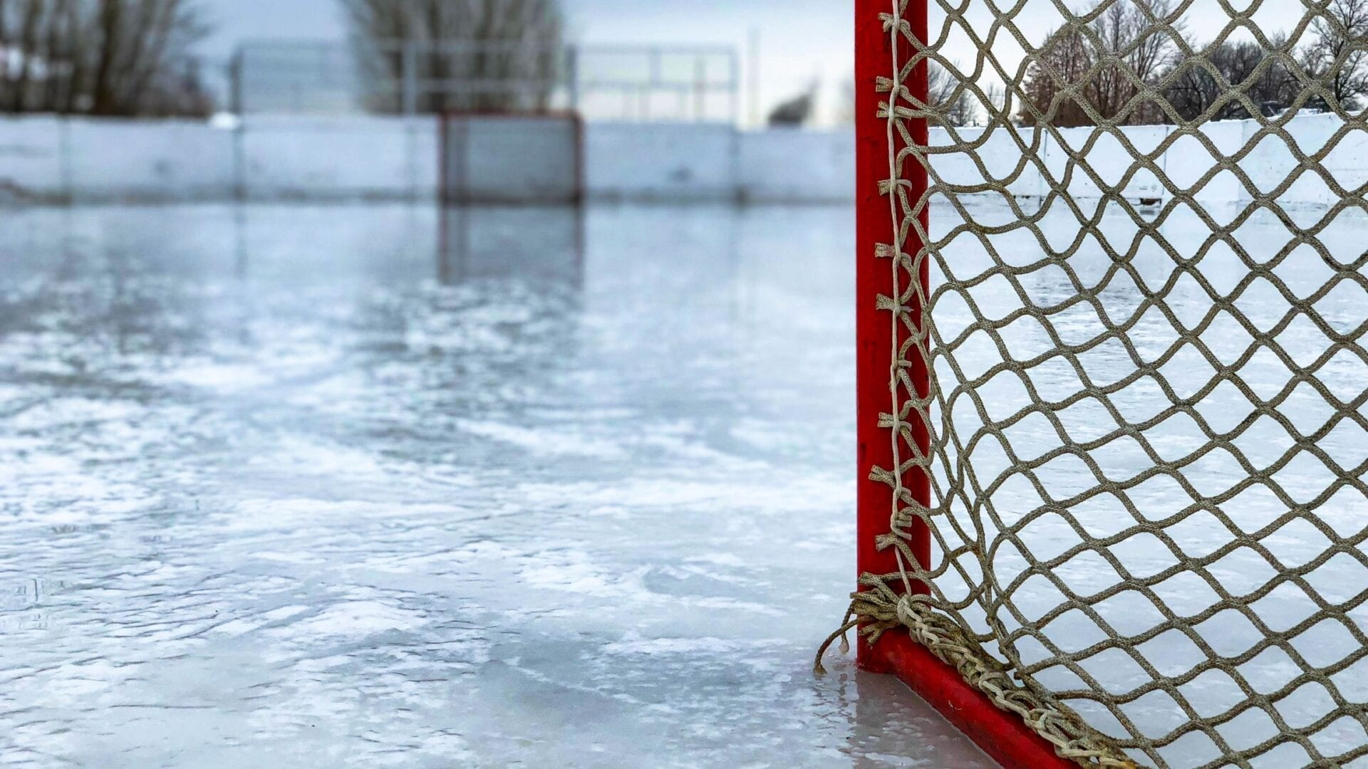 Ground level view of Hockey nets sitting on ice rink