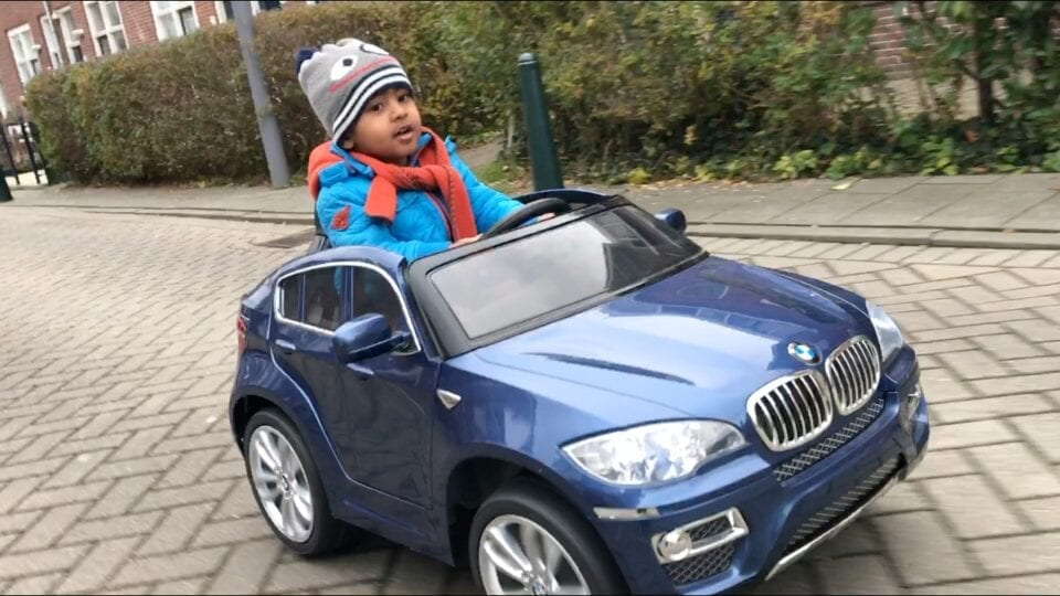 Toddler in a toy car