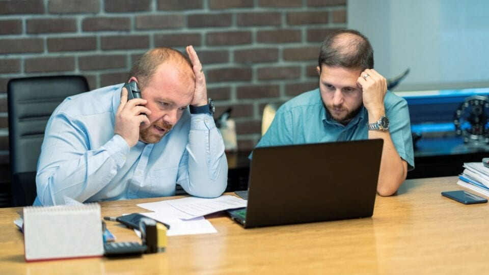 Business colleagues stressed over cyber security attack