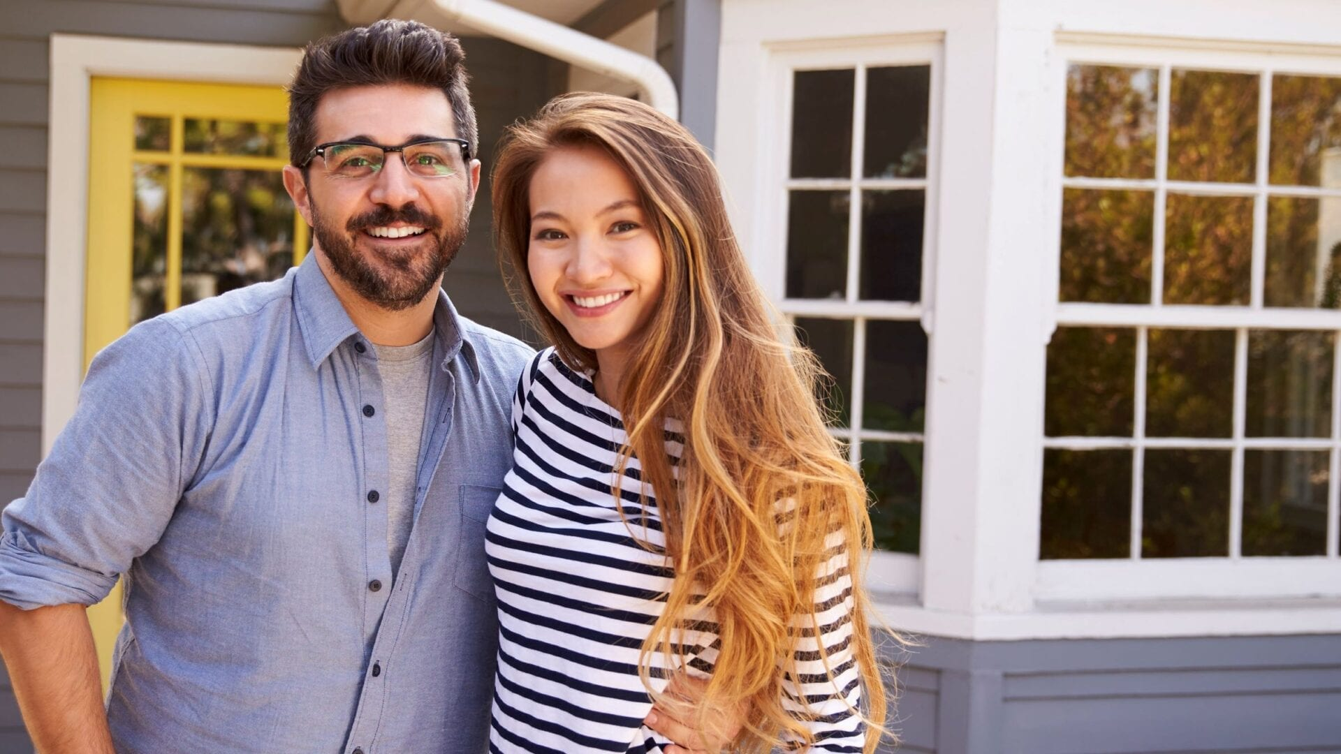 couple in front of their home