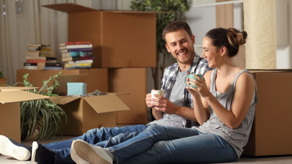 Tenants relaxing after moving in to their apartment